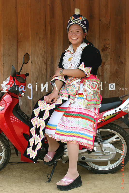 Asia, Laos, girl in traditional costume with scooter